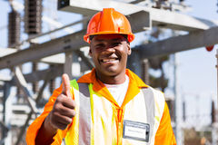 Electrician thumb up. Portrait of african electrician with thumb up at substation Royalty Free Stock Photos
