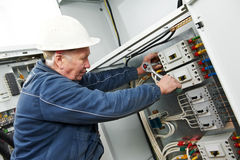 Electrician tighten the screws with spanner Stock Photography
