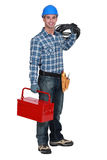 Electrician with a toolbox. Electrician with a red toolbox Royalty Free Stock Image