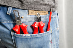 Electrician tools in back pocket Stock Image