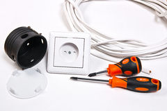 Electrician tools, cable, box for installation of sockets and wa Royalty Free Stock Images