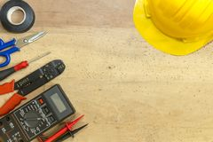 Electrician tools, components and instruments on a wooden background royalty free stock image