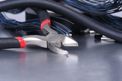 Electrician tools on metal board Stock Photos