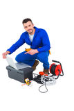 Electrician using laptop Royalty Free Stock Photography