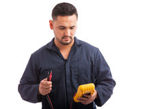 Electrician using a multimeter Royalty Free Stock Image