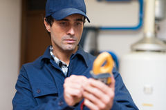 Electrician using a tester at work Royalty Free Stock Image