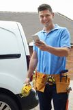 Electrician With Van Sending Text Message On Mobile Phone Outsid Stock Photos