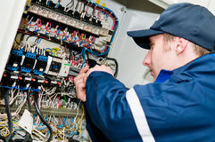 Electrician at voltage adjusting Royalty Free Stock Image