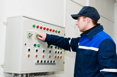 Electrician at voltage adjusting Stock Photo