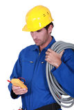 Electrician with voltmeter. And cables royalty free stock photos