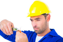 Electrician wearing hard hat while cutting wire Royalty Free Stock Photography