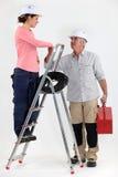 Electrician welcoming  helper Stock Photos