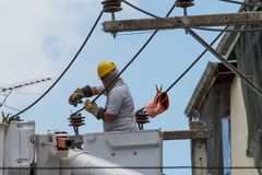 The electrician went up to the crane basket. To install the power pole Stock Images