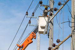 Electrician were working to repair power lines. Royalty Free Stock Image