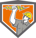 Electrician Wield Lightning Bolt Side Crest. Illustration of an electrician construction worker wield holding a lightning bolt set inside shield crest done in Royalty Free Stock Images
