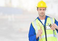 Electrician with wires cables on building site Stock Photography