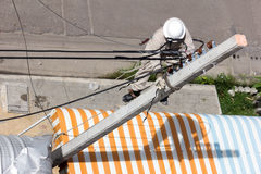 Electrician wiring on a electric pole Stock Images