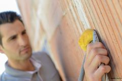 Electrician wiring a house. Building Stock Image