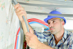 Electrician wiring new building Royalty Free Stock Image