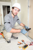 Electrician wiring up a home Stock Image