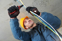 Electrician at wiring work stock images