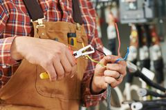Electrician at wiring work Stock Photography