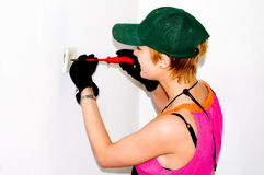 Electrician woman. Working on power outlet at construction site. Home improvemant Stock Photography