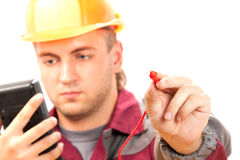 Electrician at work. Isolate on white Stock Images