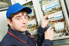 Electrician at work. One electrician working on a industrial panel mounting and assembling new wiring Stock Photos