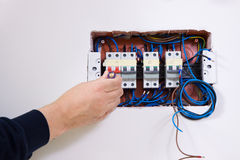 Electrician at work. In a building site Royalty Free Stock Photography