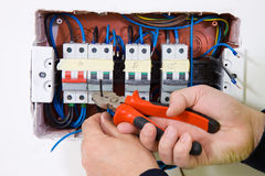 Electrician at work. In a building site Stock Photography