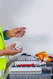 Electrician at work. With an electrical device Royalty Free Stock Photo