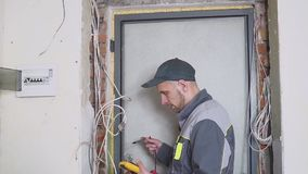 Electrician at work measures the electric current.  stock video footage