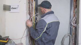Electrician at work measures the electric current.  stock footage