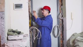 Electrician at work measures the electric current.  stock video