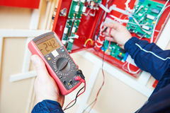 Electrician work with multimeter tester. Electrical equipment. Electrician with tester multimeter in the hands measuring current voltage royalty free stock photography
