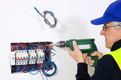 Electrician at work. In a new plant Royalty Free Stock Images