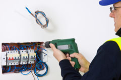 Electrician at work. In a new plant Stock Photo