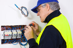 Electrician at work. In a new plant Stock Photography