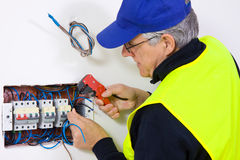 Electrician at work. In a new plant Stock Photos
