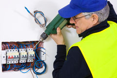 Electrician at work. In a plant Stock Image