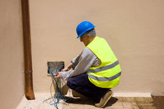 Electrician at work in a plant Royalty Free Stock Photo
