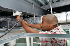Electrician worked in ceiling panel stock photos