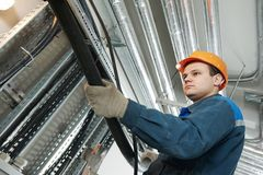 Electrician worker at cabling Stock Photo