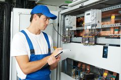 Electrician worker inspecting Stock Photo