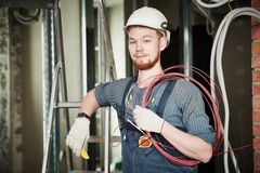 Electrician worker with wiring Stock Images