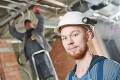 Electrician worker with wiring Stock Image