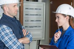 Electrician workers with switching on electric power Royalty Free Stock Images