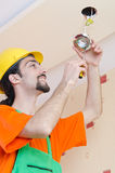 Electrician working on cabling Royalty Free Stock Images