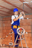 Electrician working on ceiling wires Royalty Free Stock Images